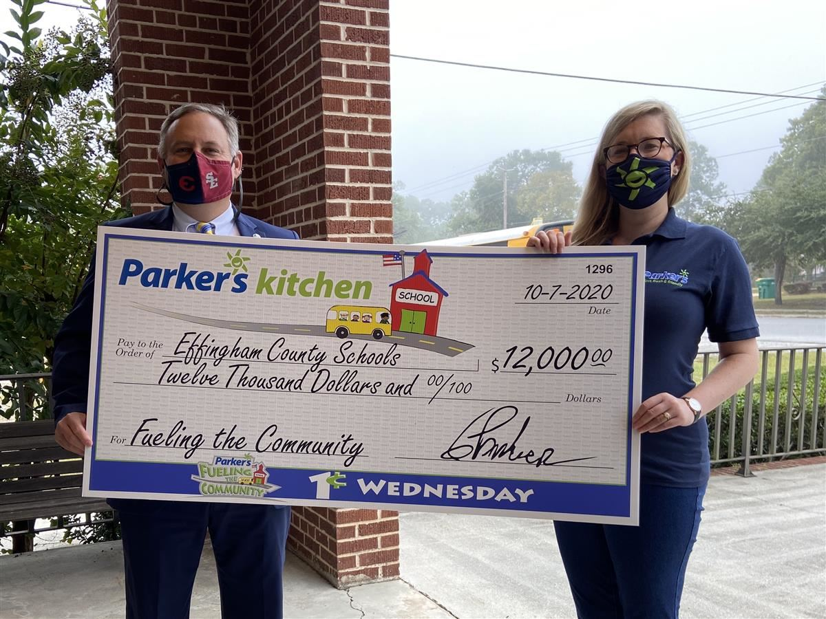 Superintendent Dr. Ford receives donation from Parker's